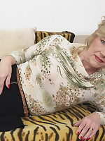 This naughty mature lsut plays with her toy boy